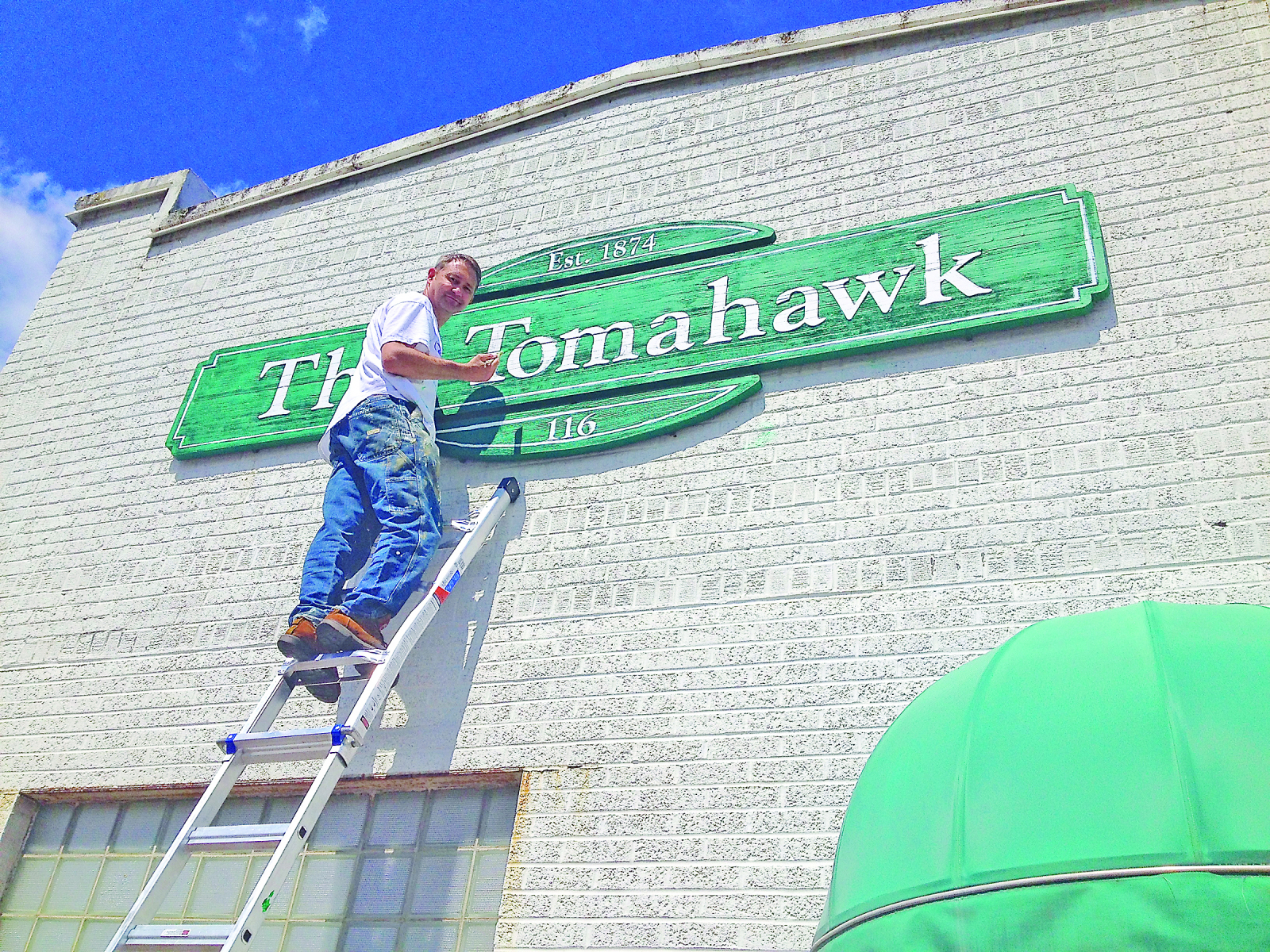 Painting-the-Tomahawk-sign-CMYK