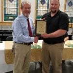 The Business of the Year award was presented by Steve Bishop, left, to Mike Barnette of Big John's Closeouts.