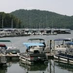 A sailboat takes advantage of a breezy day on Watauga Lake earlier this week, while dozens of boats await their captains at the start of the 2019 summer boating season. With boating season in full swing, local agencies are urging boaters to wear life jackets and keep boating safety in the forefront while on the water.   Photo by Tamas Mondovics