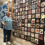 Tennessee Sunrise Quilt Guild member, Ann Rhymer, stand by the quilt Splendid Sampler, which took her more than year to make. Quilted by Joyce Gryder, the quilt was one of dozens on display during the annual Long Journey Home celebration in Mountain City earlier this month.